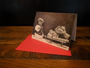 Season's Greeting Card with a Cat Pulling a Sledge