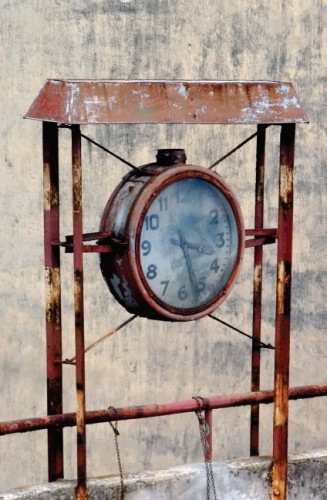 Union Relojera Suiza Vintage Clock remains in a parking lot, Alameda de Urquijjo Bilbao Spain by Arjan Richter (CC Licence)